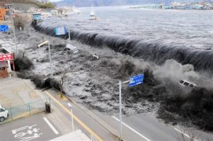 A tsunami hitting Japan in 2011. Photo source: Internet