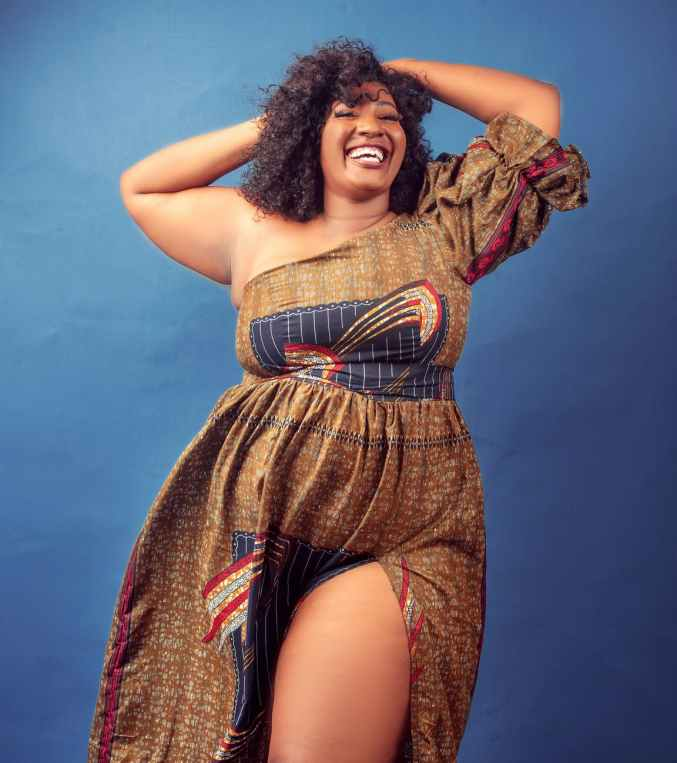 positive plump black woman smiling happily