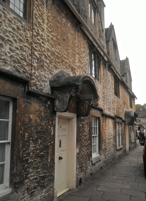 Unusual stone door portico. Houses are on street leading to the church.