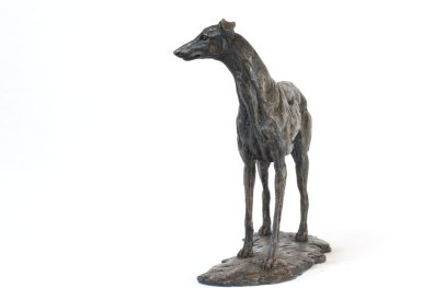 Front quarter left view of greyhound sculpture
