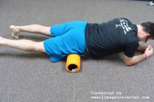 Place foam roller beneath the top of the hip bone. Lie with one hip on the roller. Opposite hip is off the foam roller. For plantar fasciitis treatment.