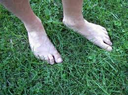 Barefoot in grass. Free your feet.