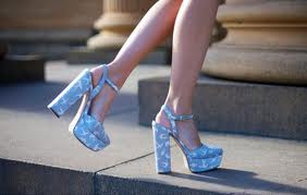 Feet in high heels. These are not happy feet. Free your feet.