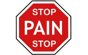 "Stop sign with ""Stop Pain Stop"". Pushing Through The Pain"