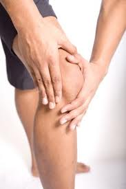 Person with knee pain. Pushing Through The Pain