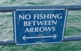 Sign guy was too busy thinking about fishing.