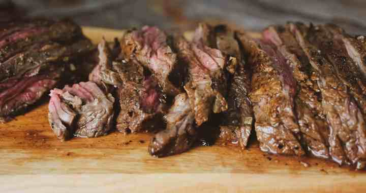 carne asada cut into strips on cutting board