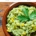 Pinterest graphic of creamy poblano rice w/ corn in a small bowl shot from above.