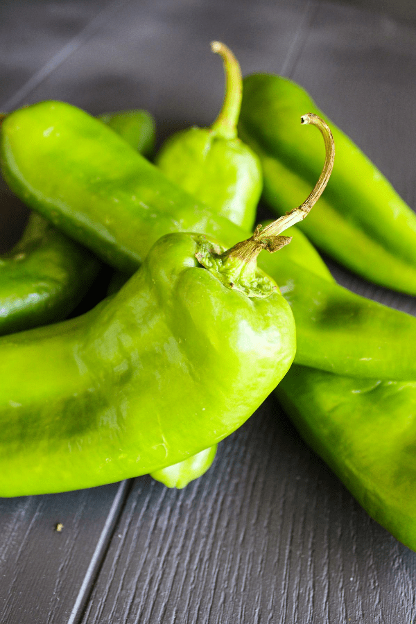 Close-up shot of pile of raw hatch chile peppers.