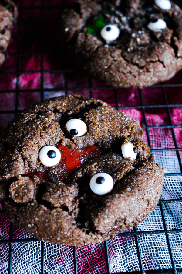 Close up of single chocolate crinkle cookie w/ zombie blood.