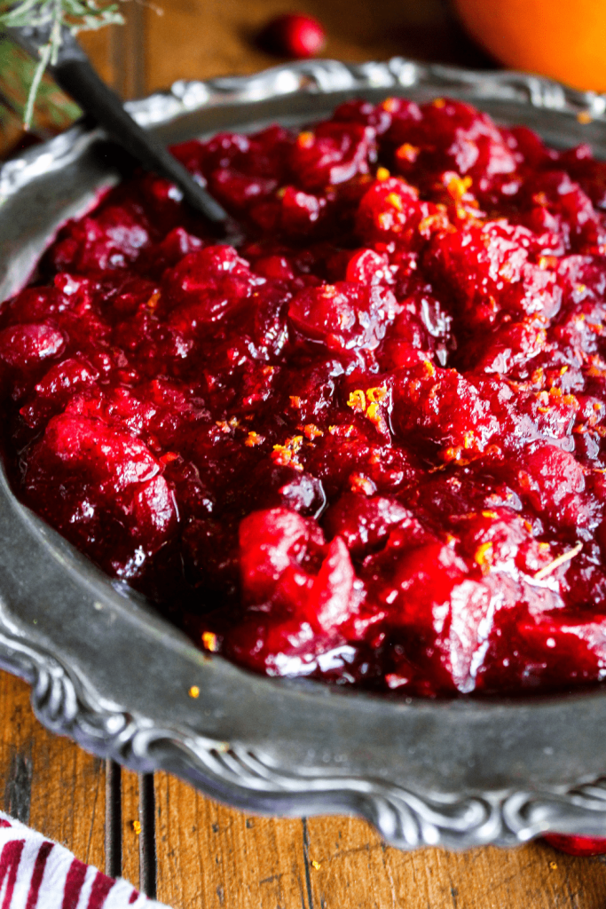 Close-up of cranberry sauce with cardamom and orange zest.