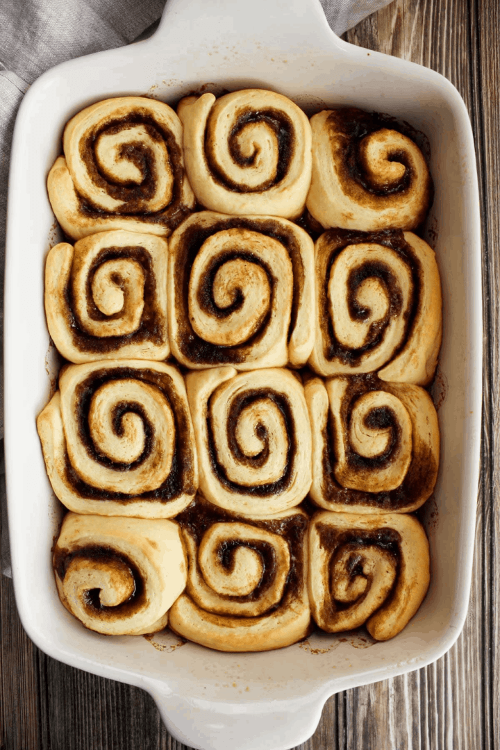 Top down shot of baked cinnamon rolls prior to icing.
