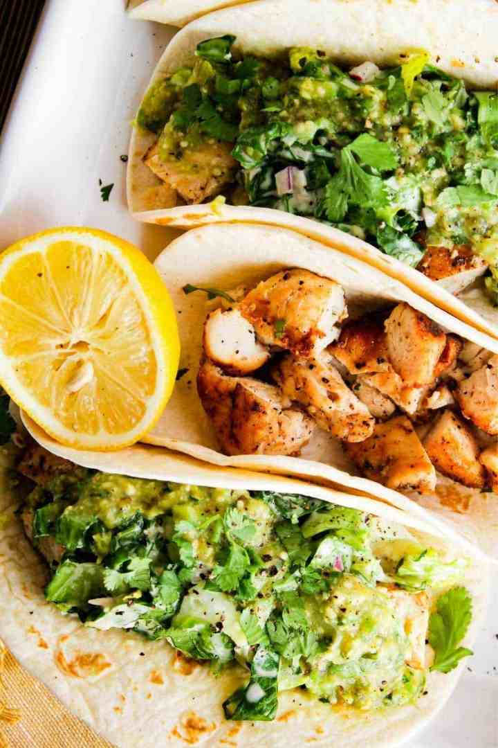 Close up of chipotle chicken Caesar tacos.