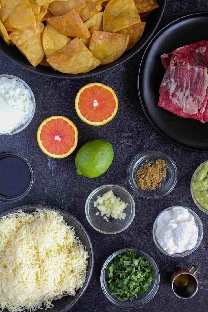 Ingredients for carne asada nachos (see recipe card).