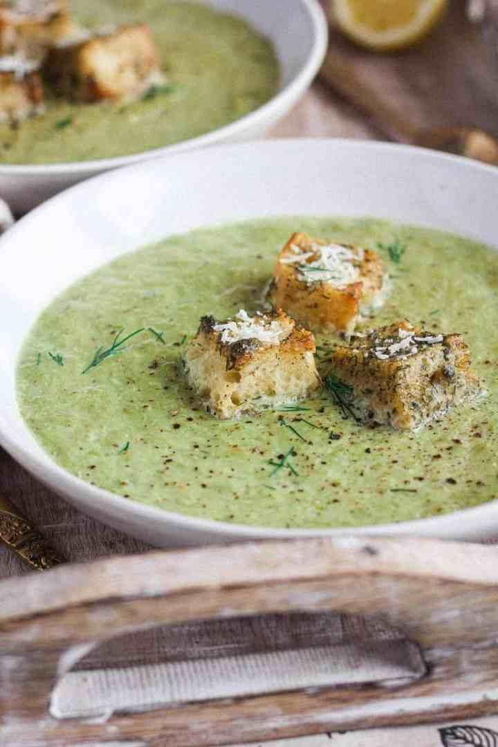 Close up of bowl of asparagus leek soup.