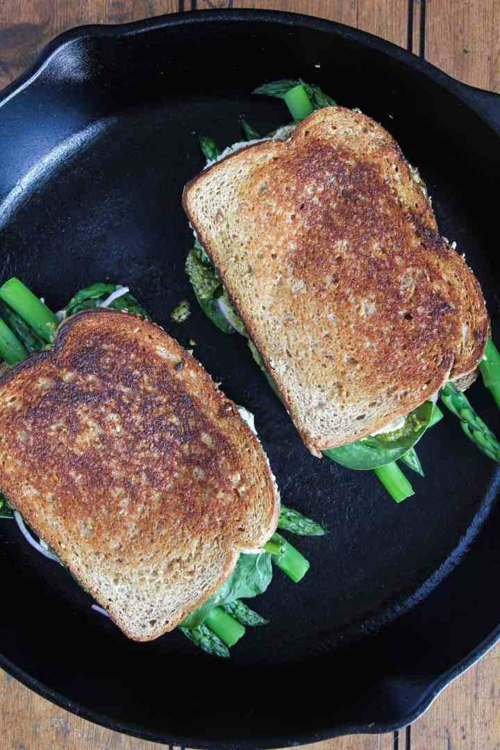 Pesto grilled cheese in a cast-iron skillet.