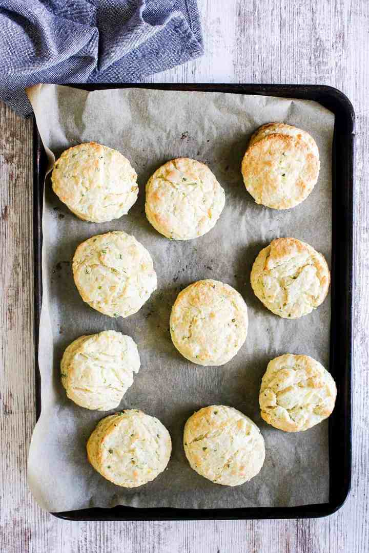 Cooked biscuits on sheet pan.