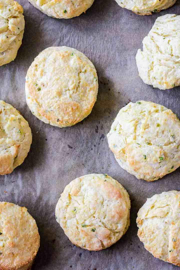 Close up of cooked biscuits on a sheet pan.