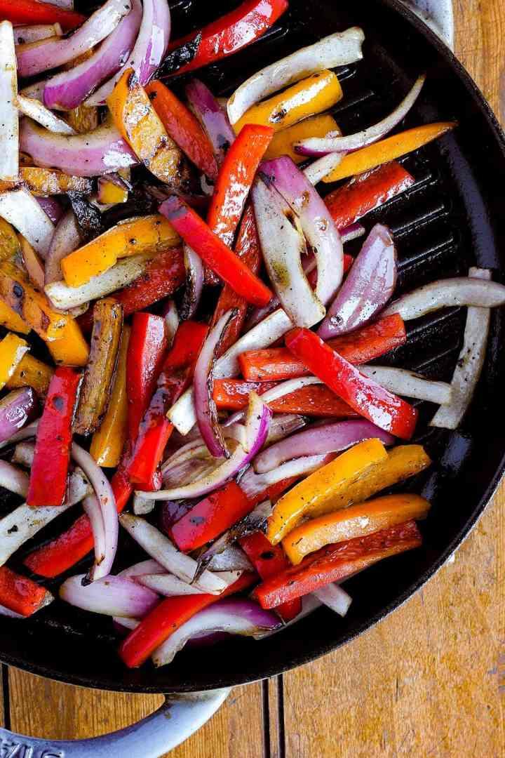 Fajita veggies in pan.
