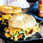 Pinterest graphic for bacon, egg, and cheese bagel with Cholula hollandaise.