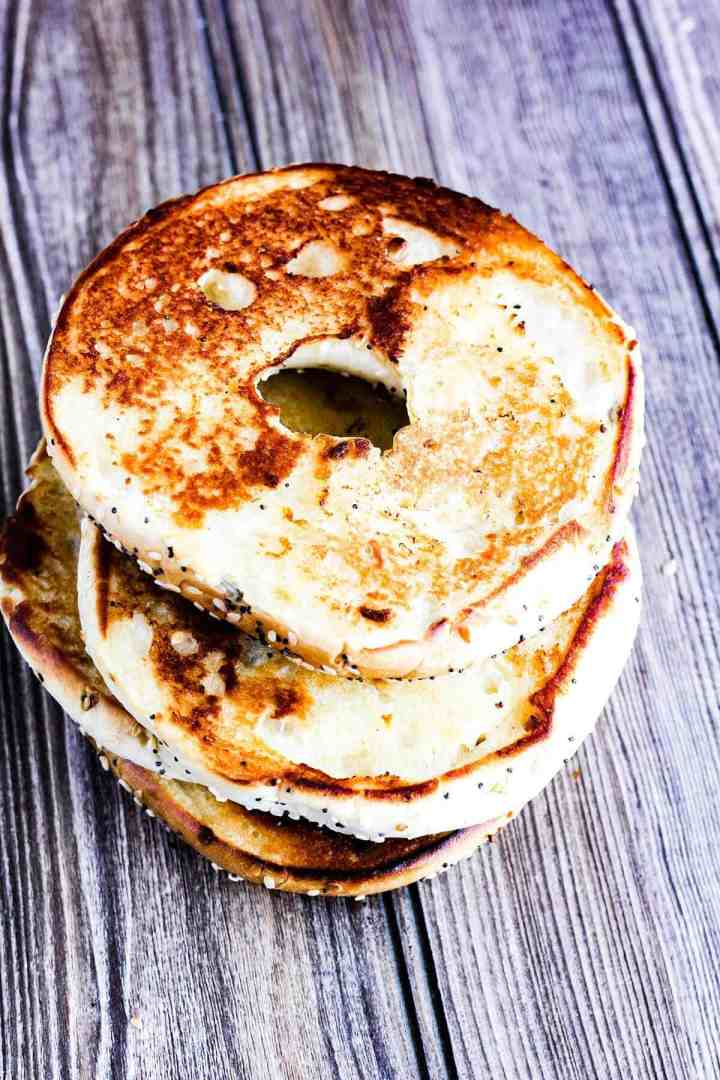 Stack of toasted bagels.