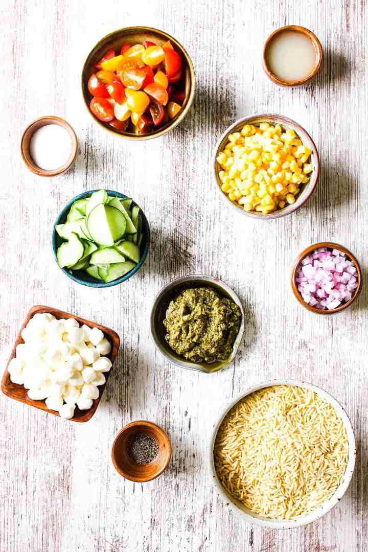 Ingredients for pesto orzo salad with summer vegetables (see recipe card).