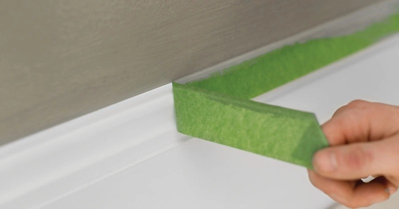 removing painter's tape from baseboard