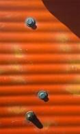 Orange corrugated panel