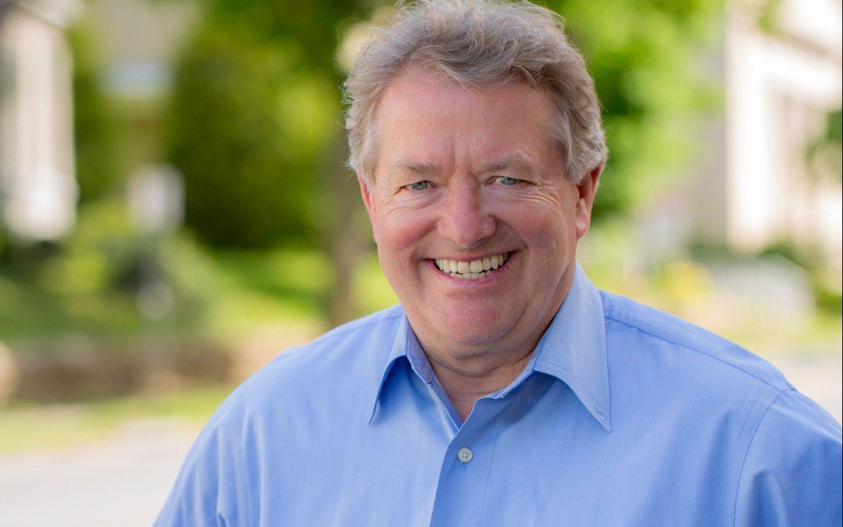 Man smiling at camera outside