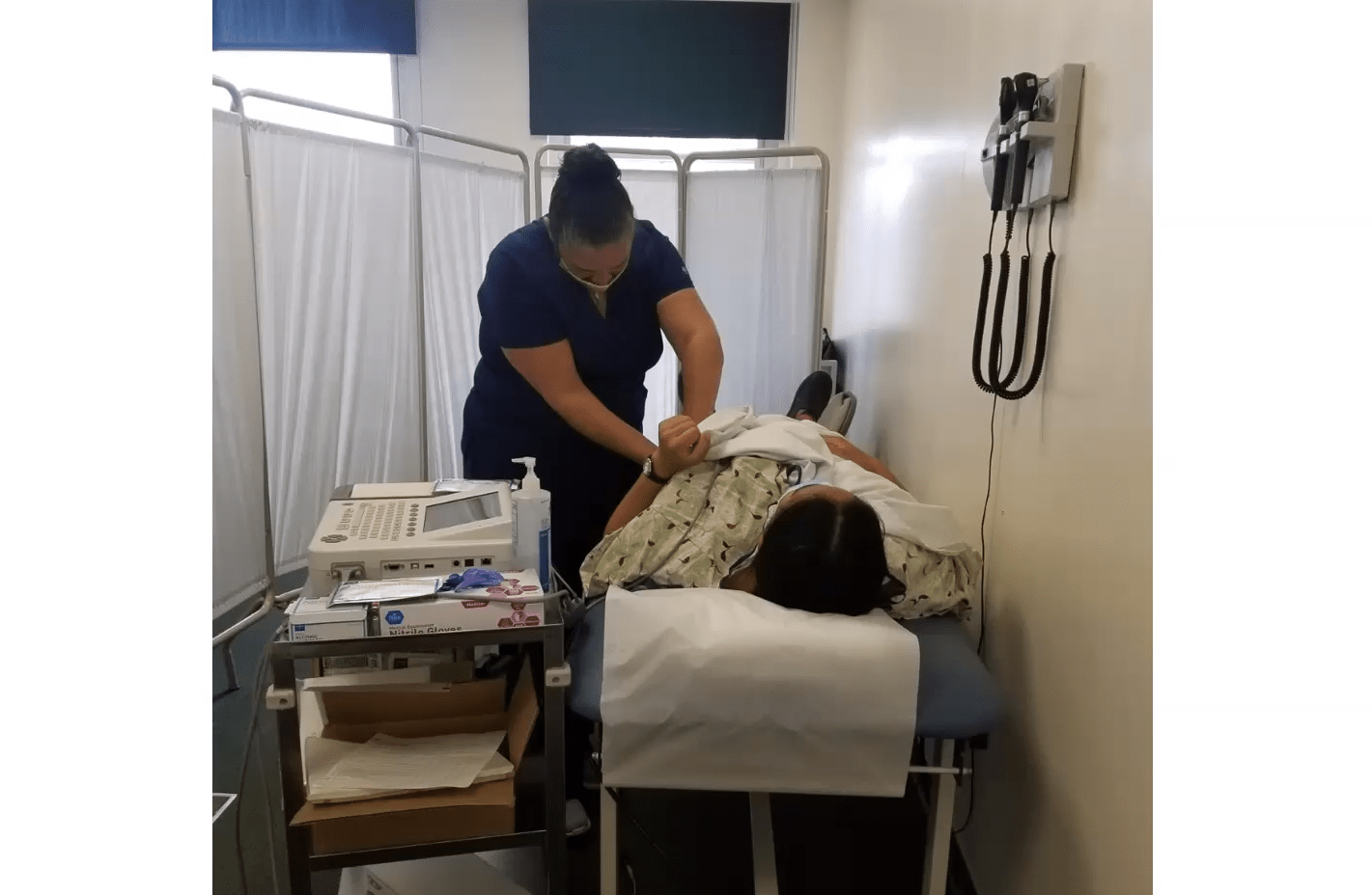 Medical student working with patient