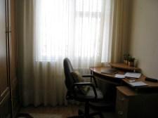 Desk, wardrobe, and window in my room