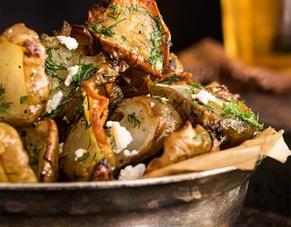 Roasted Jerusalem Artichokes with feta and garlic dill butter