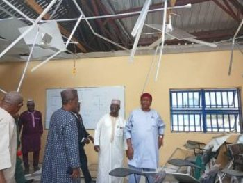 His Excellency inspecting the damage caused by the rainstorm at the University.
