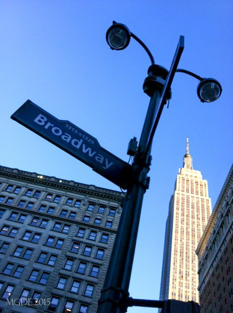 Broadway street with the Empire State at a distance.