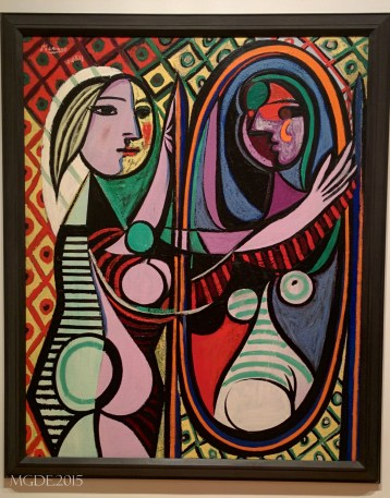 Girl before a Mirror by Pablo Picasso, 1932.