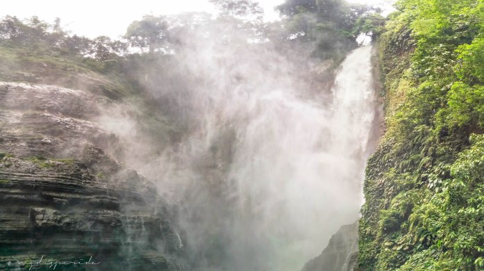 Panoramic view of waterfalls 2, creating misty surroundings.