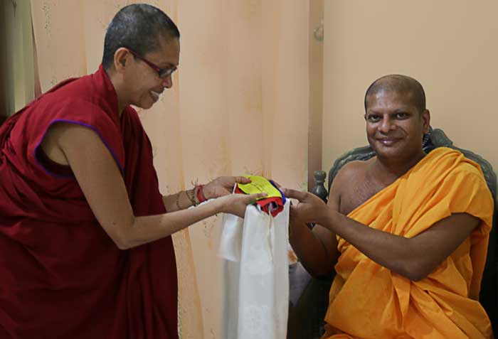 Head monk from the Abhayagiri Vihara Temple accepting a Tibetan flag offering