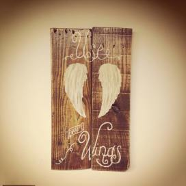 Repurposed shipping palette boards made into whimsical wings sign