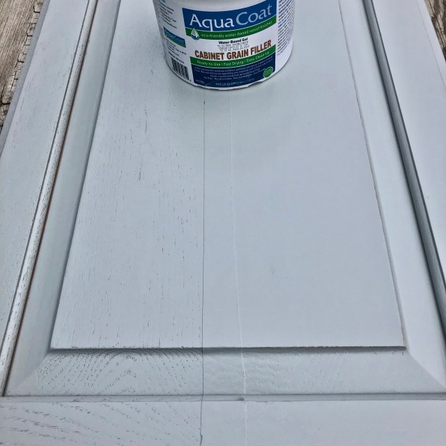 white cabinet grain filler