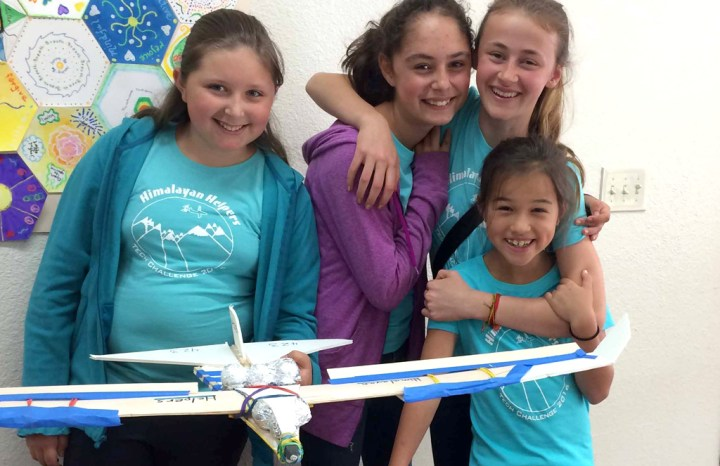 Elementary school kids with their model airplane