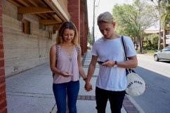 "Logan LaFleche, 22, and Ben Straw, 21, hold hands as they walk on the Flagler College campus in St. Augustine, Florida on Thursday, March 9, 2017. LaFleche stated, ""We try not to let our phones distract us when we are together, but sometimes we just can't help it when a Snapchat or a message comes up."" Psychology Today found during a study that young adults prefer communicating through cell phones rather than in person."