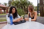 "Genna DeFalco, 21, and Rachel Kennedy, 21, sit on their phones together on the Flagler College campus in St. Augustine, Florida on Thursday, March 9, 2017. Kennedy said, ""I wouldn't say that I am addicted to my phone, but I am definitely am on Instagram more than I should be."""