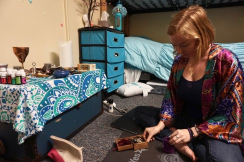 Alicia Simpson, 20, at her altar in her dorm room at Flagler College in St. Augustine, Florida on Wednesday, April 12, 2017. Paganism is defined as a modern religious movement incorporating beliefs or practices from outside the main world religions, especially nature worship.