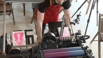 "Ryan Tempro, 26, commencing the process of letterpress printing in his letterpress shop in St. Augustine, Florida on Monday, February 13, 2017. Tempro stated, ""My favorite part about my job is probably working with so many different clients, and it's probably a toss up between that and making people laugh."""