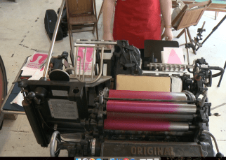 "Ryan Tempro, 26, monitoring the letterpress in his letterpress shop in St. Augustine, Florida on Monday, February 13, 2017. When asked about his work, he said, ""The things that I make often insight people to laugh, or to smile, or maybe even cringe at sort of what it says and how cheeky it all might be."""