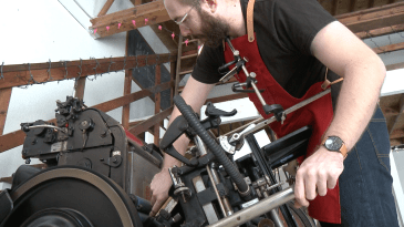 Ryan Tempro, 26, screwing in his newly designed print in his letterpress shop in St. Augustine, Florida on Monday, February 13, 2017. The process of letterpress printing is very tedious and time consuming. Tempro works at graceful pace in order to perfect any print he has made.