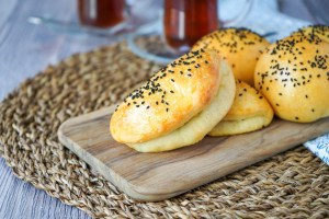 Peynirli Poğaça (Turkish Feta Buns) on a wooden board.