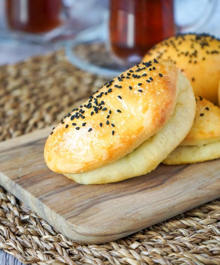 Peynirli Poğaça (Turkish Feta Buns) on a wooden board.