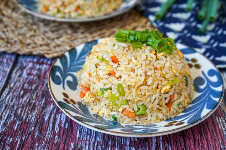 Chahan (Japanese Fried Rice) shaped into a dome and topped with sliced green onions.