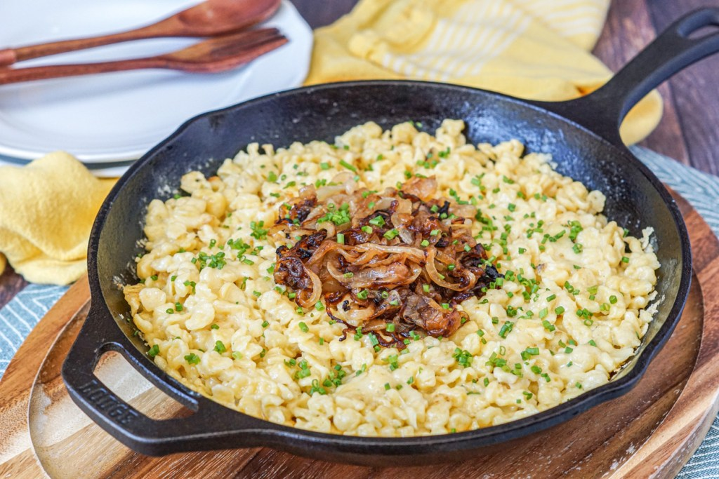 Kasnocken (Austrian Dumplings with Cheese and Onions) in a skillet